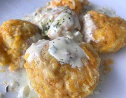 Kürbisnockerl mit Sahnesauce und Parmesan